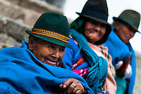 "Old women, wearing blue ponchos, watch a procession during the Inti Raymi celebration in Pichincha province, Ecuador, 26 June 2010. Inti Raymi, ""Festival of the Sun"" in Quechua language, is an ancient spiritual ceremony held in the Indian regions of the Andes, mainly in Ecuador and Peru. The lively celebration, set by the winter solstice, goes on for various days. The highland Indians, wearing beautiful costumes, dance, drink and sing with no rest. Colorful processions in honor of the God Inti (Sun) pass through the mountain villages giving thanks for the harvest and expressing their deep relation to the Mother Earth (Pachamama)."