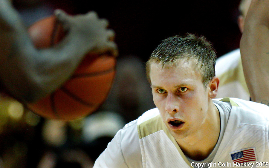 TALLAHASSEE, FL 12/11/09-FSU-AU BB09 CH35-Florida State's Deividas Dulkys keeps his eyes on the ball as  Auburn advances during second half action Thursday at the Donald L. Tucker Center in Tallahassee. The Seminoles beat the Tigers 76-72...COLIN HACKLEY PHOTO