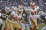 San Francisco 49ers running back Kevan Barlow (32) outruns Raider defenders on Sunday, November 3, 2002, in Oakland, California. The 49ers defeated the Raiders 23-20 in an overtime game.