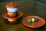 Photo shows the unique lacquerware saucers used to serve tea at Dogo Onsen, thought to be Japan's oldest spa in Matsuyama City, Ehime Prefecture, Japan on 20 Feb. 2013.  The tea is served with Botchan dango sweets, a specialty of the area. The white heron seen on the tea cup is a recurring motif at the spa, dating back to a legend that says a lame heron was cured by the waters here,  triggering the establishment of the first community here about 3,000 years. Photographer: Robert Gilhooly