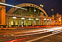 TH00239-00...THAILAND -  Busy road in front of the Hua Lamphon Railroad Station in Bangkok in the evening.