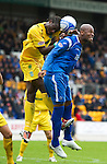 St Johnstone v Hibs...02.10.10  .Michael Duberry and Sol Bamba.Picture by Graeme Hart..Copyright Perthshire Picture Agency.Tel: 01738 623350  Mobile: 07990 594431