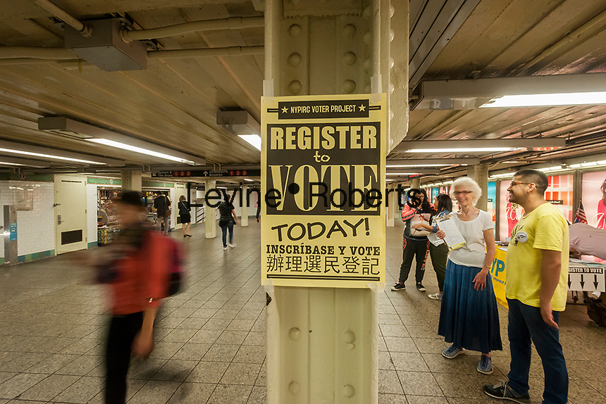 Volunteers from NYPIRG celebrate National Voter Registration Day in the Times Square subway station in New York on Tuesday, September 27, 2016. The table was set up in a high traffic area and the volunteers enticed the non-registered to register to vote. (© Richard B. Levine)