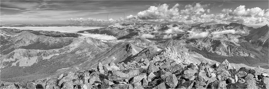 This Colorado black and white landscape image shows the view from one of Colorado's iconic 14,000 feet mountains - a panoramic vista from the summit of Mount Yale. It is a long hike up this majestice mountain. The nearest town is Buena Vista, but the trailhead is still a long way from here.<br /> <br /> On our ascent of this peak, what you can't see is the thin layer of ice that had frosted the rocks. Along with a slippy path, the winds were howling - probably 60-70 mph here. I was worried about my tripod being blown over, so I had to hold the base of the tripod the entire time. While it was an amazing view of the Rocky Mountains, I was ready to descent to lower elevations on this morning.