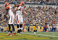 PITTSBURGH, PA - DECEMBER 04:  A.J. Green #18 celebrates with teammate Colin Cochart #81 of the Cincinnati Bengals after Green scored a touchdown against the Pittsburgh Steelers during the game on December 4, 2011 at Heinz Field in Pittsburgh, Pennsylvania.  (Photo by Jared Wickerham/Getty Images)