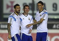 Ezequiel Lavezzi, Lionel Messi and Angel Di Maria of Argentina share a joke during training