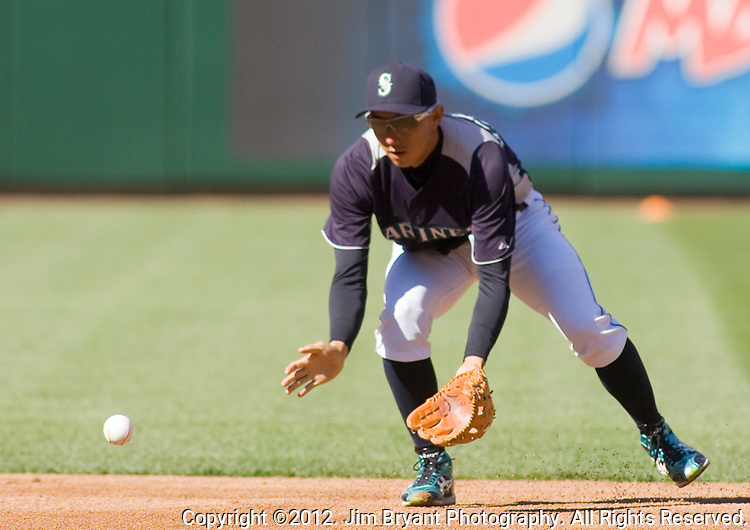 Seattle Mariners second baseman  Munenori Kawasaki, of Japan, fields hits before the Mariner's  opening home game of the season with the Oakland Athletics at SAFECO in Field Seattle April 13, 2012. . © 2012. Jim Bryant Photo. All Rights Reserved..