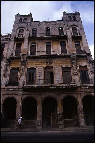 Latino Man Jogging Past Old Building, Havana, Cuba by Paul Cooklin