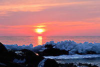 &quot;Frozen Sunrise&quot;<br /> <br /> The sun rises over Lake Superior, illuminating its thin sheet of ice along the North Shore.