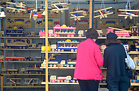 Customers look at the handmade wooden toys at the Woodsman booth during the Contemporary Crafts Market at the Santa Monica Civic Auditorium on  June 8, 2012...
