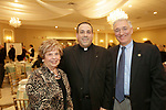 Watertown, CT- 30 March 2017-033017CM05-  From left,  Emma Barone co-chair of the event, Father Jeffrey Romans of St. Bridget's of Cheshire, with Thomas Becket of Cheshire are photographed during The St. Vincent DePaul Mission of Waterbury annual banquet at The Grand Oak Villa in Oakville.  Christopher Massa Republican-American