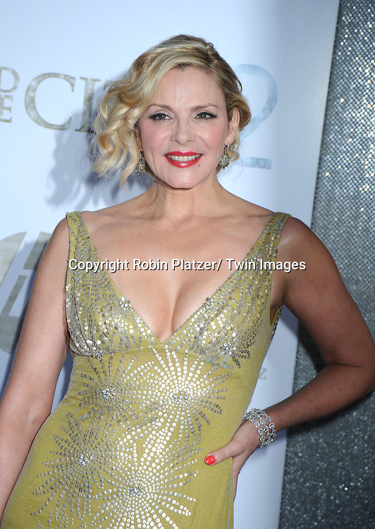 """actress Kim Cattrall  posing for photographers at the world premiere of """"Sex and the City 2"""" on May 24, 2010 at Radio City Music Hall in New York City."""
