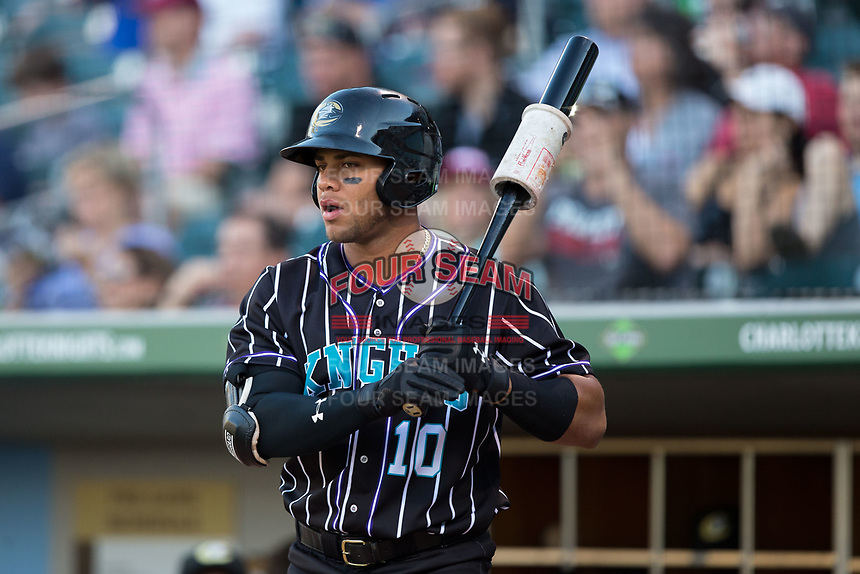 Yoan Moncada (10) of the Charlotte Knights waits for his turn to bat during the game against the Norfolk Tides at BB&T BallPark on May 2, 2017 in Charlotte, North Carolina.  The Knights defeated the Tides 8-3.  (Brian Westerholt/Four Seam Images)