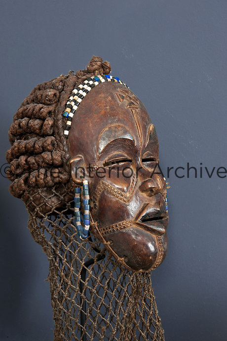 Close up of 'Chokwe' one of the Congo masks collected by the owner made with wood and beads