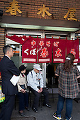 "People queue to enter the very established, very highly regarded and traditional ( or ""old school"") 'Harukiya' ramen noodle restaurant in Ogikubo district of Tokyo, Japan, Friday 30th April 2010."