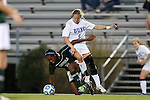 10 November 2012: Loyola Maryland's Kelsey Rene (left) is fouled by Duke's Kaitlyn Kerr (right). The Duke University Blue Devils played the Loyola University Maryland Greyhounds at Koskinen Stadium in Durham, North Carolina in a 2012 NCAA Division I Women's Soccer Tournament First Round game. Duke won the game 6-0.