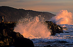 Northern California Crescent city ruff surf with waves breaking onto jetty with rock formations at sunset Crescent City California USA