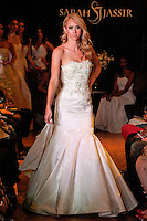 Model walks the runway in a Luster wedding dress - silk crepe back satin/crochet lace satin halter gown, by Sarah Jassir, for the Sarah Jassir Couture Bridal Fall 2012 Opulence collection.