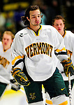 30 January 2010: University of Vermont Catamount forward Wahsontiio Stacey, a Junior from Kahnawake, Quebec, awaits the start of play prior to a game against the University of Maine Black Bears at Gutterson Fieldhouse in Burlington, Vermont. The Maine Black Bears and the Catamounts played to a 4-4 tie in the second game of their America East weekend series. Mandatory Credit: Ed Wolfstein Photo
