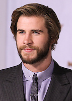 LOS ANGELES, CA, USA - NOVEMBER 17: Liam Hemsworth arrives at the Los Angeles Premiere Of Lionsgate's 'The Hunger Games: Mockingjay, Part 1' held at Nokia Theatre L.A. Live on November 17, 2014 in Los Angeles, California, United States. (Photo by Rudy Torres/Celebrity Monitor)