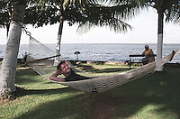 A tourist relaxes on his hammock at a luxury resort in Alleppey, Kerala, India.