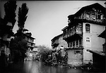 Abandoned or partially abandoned multi-family Hindu homes  line canal in Srinagar, Indian Administered Kashmir.  Many Hindu residents of this Muslim majority region have fled and not returned.