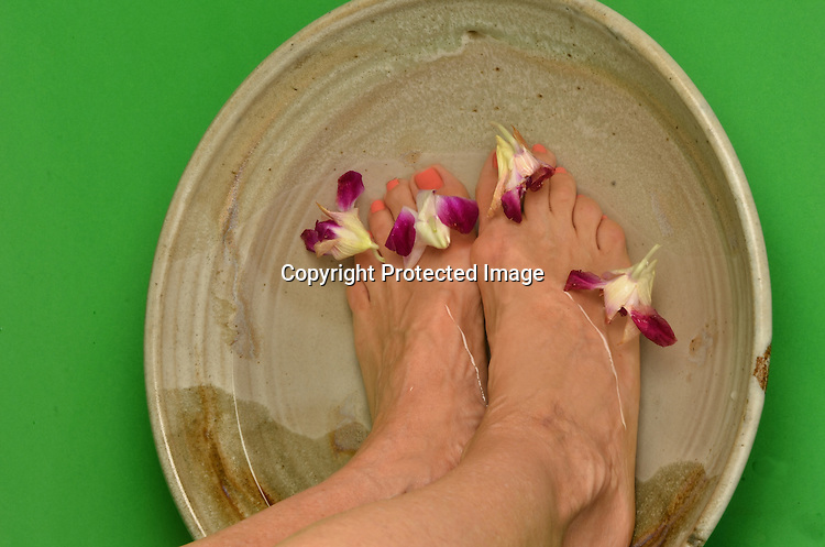 Stock photo of feet in water