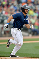Left fielder Tim Tebow (15) of the Columbia Fireflies runs toward first in a game against the Lexington Legends on Sunday, April 23, 2017, at Spirit Communications Park in Columbia, South Carolina. Lexington won, 4-2. (Tom Priddy/Four Seam Images)