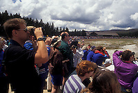 AJ3571, Yellowstone National Park, Old Faithful, Wyoming, Yellostone, Tourists gather to watch The Old Faithful Geyser erupt in Yellowstone National Park in the state of Wyoming.