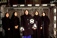 © Caroline Penn / Panos Pictures..Iranian women in sport..Tehran, Iran. October 1999...A five-a-side women's football team at the Hijab Club.