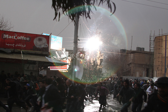 SULAIMANIYAH, IRAQ:  A stray bullet from Kurdish security forces ignites electrical cables over the heads of protesters...Tension continues to grow in the semi-autonomous region of Iraqi Kurdistan as protesters clash with police on a 5th day of unrest...Photo by Haedar Omar