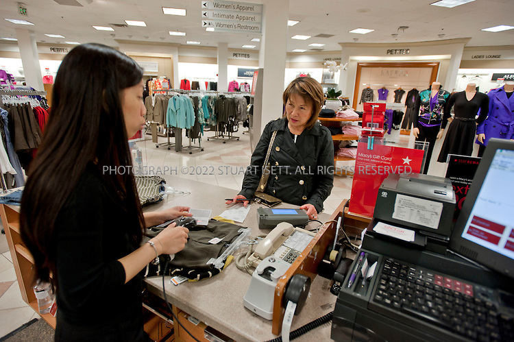 "9/23/2010--Seattle, WA, USA..Here: Sachiko Conner, 62 (right), of Bellevue WA, buys clothes at the large 'petites' section of the Macy's store at Bellevue Square, in Bellevue, WASH. She is helped by Macy's employee, Sally Pot, 30. ...Macy's in Bellevue,  WASH., near Seattle. After years of acquiring other department stores and trying to make them all look the same, retailers like Macy's and Saks are now trying to make each store seem local and authentic. The Seattle store, in Bellevue Square, has an Asian and Indian population, lots of corporate types and ""Microsoft wives,"" as the store manager referred to them...©2010 Stuart Isett. All rights reserved."