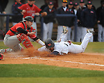 Arkansas State catcher Kyle DeGrace tags out Ole Miss Taylor Hashmanat Oxford-University Stadium in Oxford, Miss. on Tuesday, February 23, 2010. Ole Miss won 3-2.