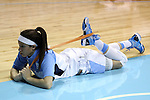 02 January 2014: North Carolina's Jessica Washington stretches before the game. The University of North Carolina Tar Heels played the James Madison University Dukes in an NCAA Division I women's basketball game at Carmichael Arena in Chapel Hill, North Carolina.