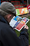 Kidderminster Harriers 3 Gainsborough Trinity 0, 19/11/2016. Aggborough, National League North. A home fan reading the match programme at Aggborough, home of Kidderminster Harriers before they played visitors Gainsborough Trinity in a National League North fixture. Harriers were formed in 1886 and have played at their current home since 1890. They won this match  by 3-0 watched by a crowd of 1465. Photo by Colin McPherson.