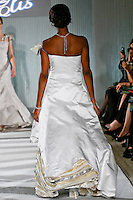 Model walks the runway in a Beth Elis Glory wedding dress by Nere Emiko during the Wedding Trendspot Spring 2011 Press Fashion, October 17, 2010.