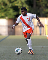 Syracuse University forward Chris Nanco (17) brings the ball forward. Boston College (maroon) defeated Syracuse University (white/orange), 3-2, at Newton Campus Field, on October 8, 2013.