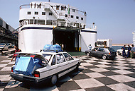 May 27, 1989, Marseilles, France --- Muslim immigration in the port city of Marseille. Passengers depart for Algeria. Cars are often loaded with products bought in France. --- Image by © JP Laffont
