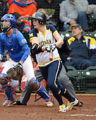 Michigan Wolverines pitcher Sara Driesenga (10) at bat during the season opener against the Florida Gators on February 8, 2014 at the USF Softball Stadium in Tampa, Florida.  Florida defeated Michigan 9-4 in extra innings.  (Copyright Mike Janes Photography)