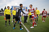 SANTA CLARA, CA - July 18, 2012: San Jose Earthquakes captain Chris Wondolowski (8) and FC Dallas captain Andrew Jacobson (4) shake hands after the coin toss prior to  the San Jose Earthquakes vs  FC Dallas match at the Buck Shaw Stadium in Santa Clara, California. Final score San Jose Earthquakes 2, FC Dallas 1.