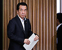 June 28th, 2011, Tokyo, Japan - Beleaguered Japanese Prime Minister Naoto Kan leaves a party caucus after delivering a remark as the ruling Democratic Party of Japan calls on a general assembly of its members at the Diet in Tokyo on Tuesday, June 28, 2011. Defining for the first time conditions for fulfilling his June 2 pledge to resign, Kan said on Monday he would resign after the passage of three key bills - the second reconstruction budget, the renewable energy bill and the bond-issuance bill. Kan has been under pressure from both the opposition and his own Democratic Party of Japan to step down over his poor handling of the March 11 earthquake and tsunami that caused the biggest nuclear catastrophe in 25 years. (Photo by AFLO) [3609] -mis-...