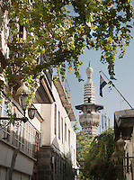 A minaret towers in the sky in the old city of Damascus, Syria