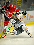 18 January 2008: University of Vermont Catamounts' forward Chris Atkinson, a Freshman from Sparta, NJ, is tripped up by Northeastern University Huskies' defenseman Louis Liotti, a Junior from Westbury, NY, during ame action at Gutterson Fieldhouse in Burlington, Vermont. The two teams battled to a 2-2 tie in the first game of their 2-game weekend series...Mandatory Photo Credit: Ed Wolfstein Photo