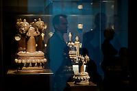 Visitor watches four-headed phallic Shiva symbols on display in the Southeast Gold Museum that presents hundreds of golden artifacts from the private collection of founder Istvan Zelnik in Budapest, Hungary on September 15, 2011. ATTILA VOLGYI
