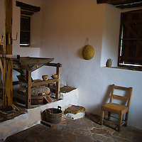 Wooden furniture and grindstone mill in Mission San Jose in San Antonio, Texas part of the San Antonio Missions National Historical Park.
