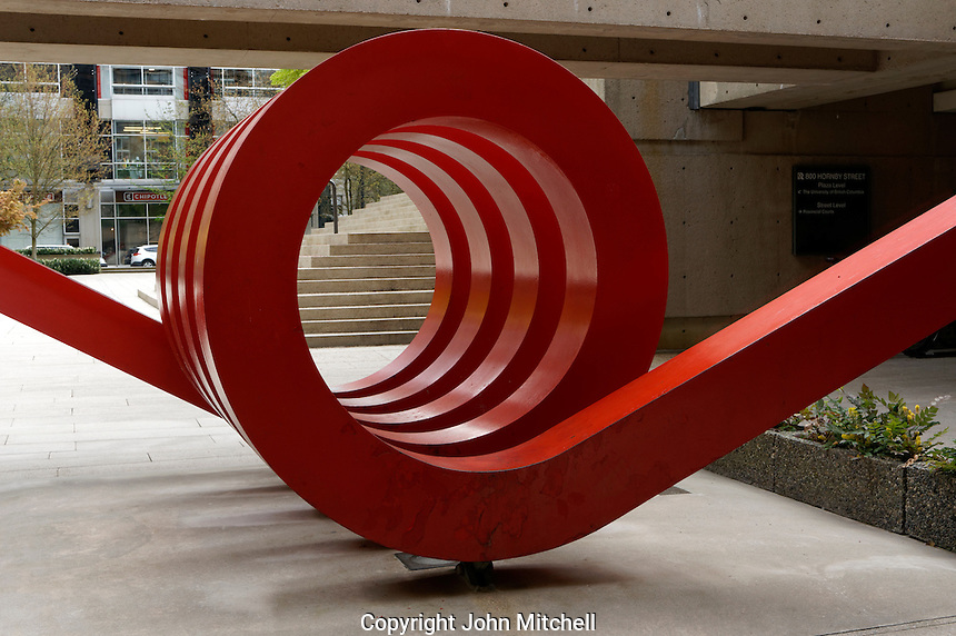 Spring, a red metal sculpture by Alan Chung Hung in Robson Square, Vancouver, BC, Canada