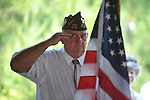 Randal Loyed salutes at the dedication of the new Veterans Park in Oxford, Miss. on Saturday, June 30, 2012.