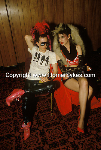 Tony James front man and lead singer of Sigue Sigue Sputnik. Punk band 1980s with Charlotte who was in charge of the sound system. Back stage before a gig. Newcastle Upon Tyne. UK