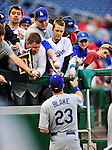 23 April 2010: Los Angeles Dodger fans ask Casey Blake for autographs prior to a game against the Washington Nationals at Nationals Park in Washington, DC. The Nationals defeated the Dodgers 5-1 in the first game of their 3-game series. Mandatory Credit: Ed Wolfstein Photo