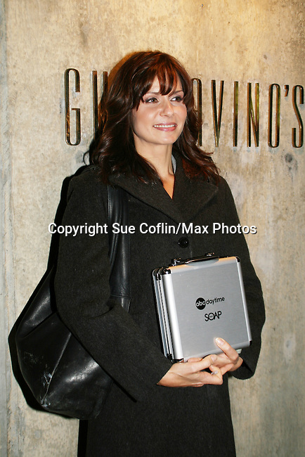 """One Life To Live's Florencia Lozano """"Tea Delgado"""" poses with the gift of poker ships, cards and dice at the ABC Daytime Casino Night on October 23, 2008 at Guastavinos, New York CIty, New York. (Photo by Sue Coflin/Max Photos)"""